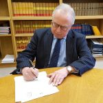 Lord Justice Gross signing letter of exchange for cooperation