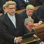 Photo of Richard Atkins QC, Chair of the Bar, standing, and Simon Davis, President-Elect of the Law Society, seated.