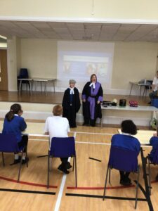 Her Honour Judge Sarah Venn with a pupil in judicial dress